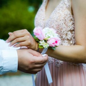 Placing a corsage on hand
